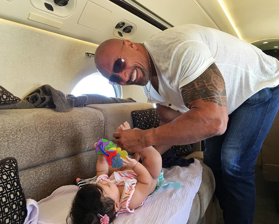 the rock changes diaper of daughter jasmine on plane