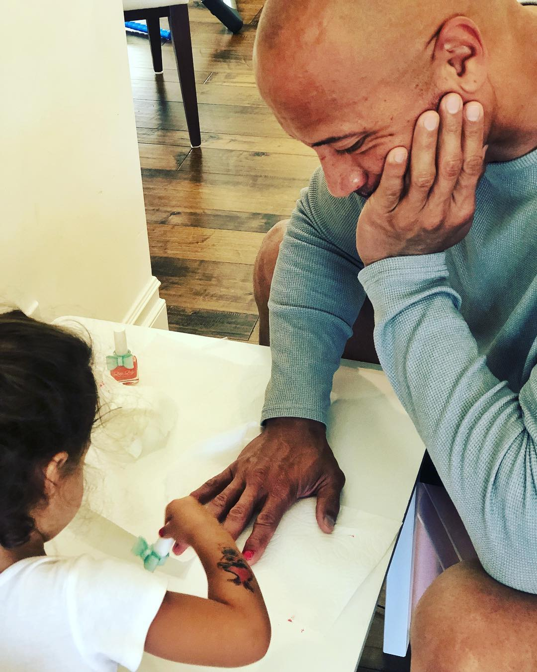 the rock getting his nails painted before going to work