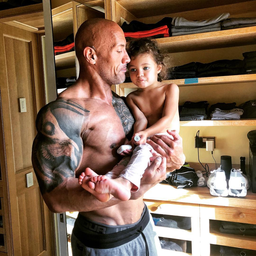 dwayne the rock johnson holding his two year old daughter jasmine