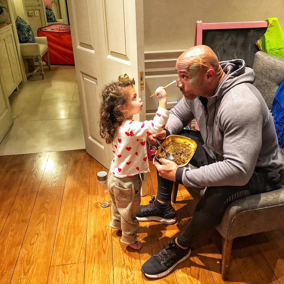the rock having his face painted by daughter