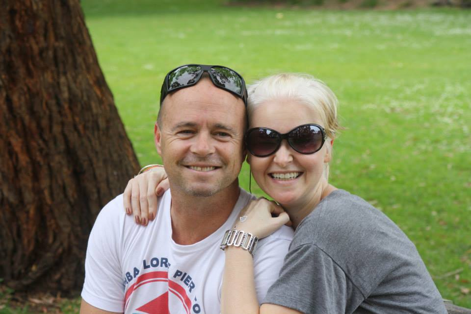 chris and renee martin in a park