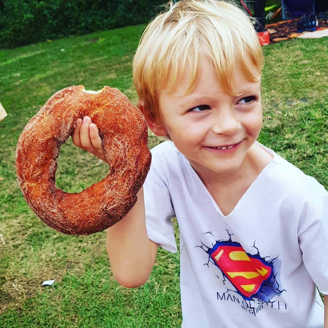 chris martin's son with a donut