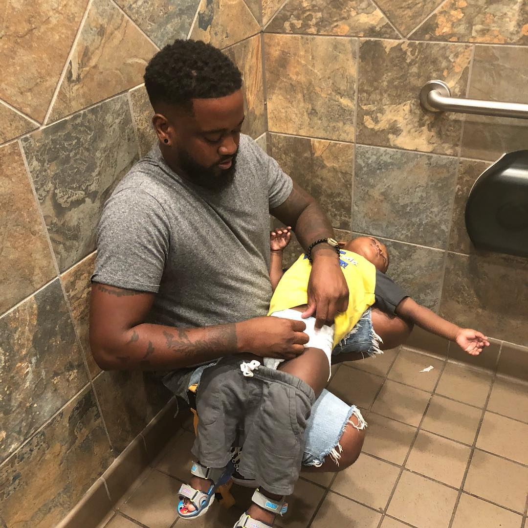 donte palmer squatting while changing diaper