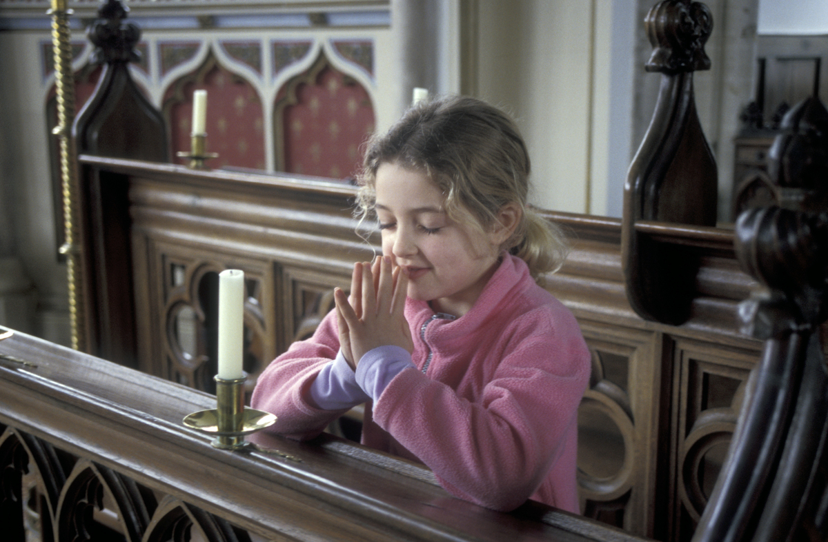 small girl in church in UK