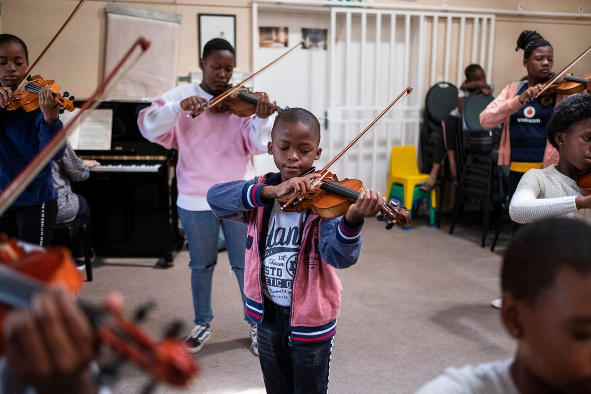 child playing violin in Soweto