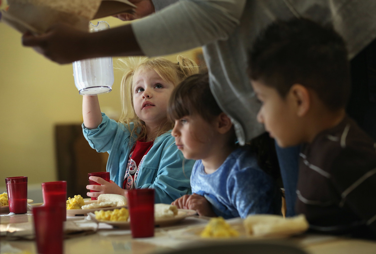 children eating at head start program in NY 2012