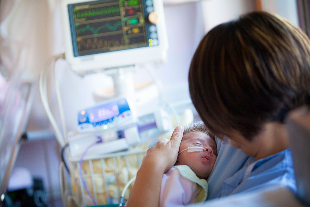 A new mother looks after her premature baby