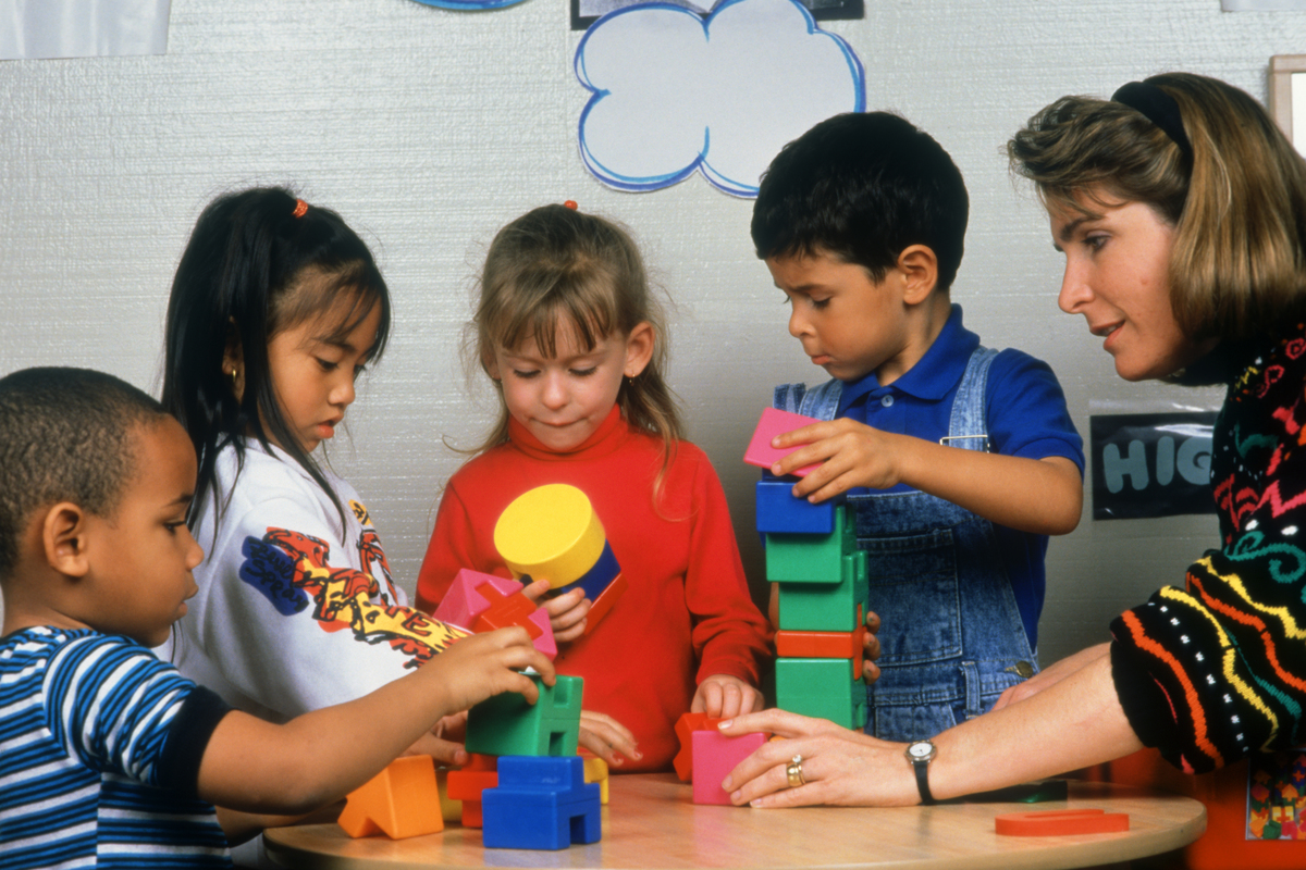 toddlers in classroom with teacher