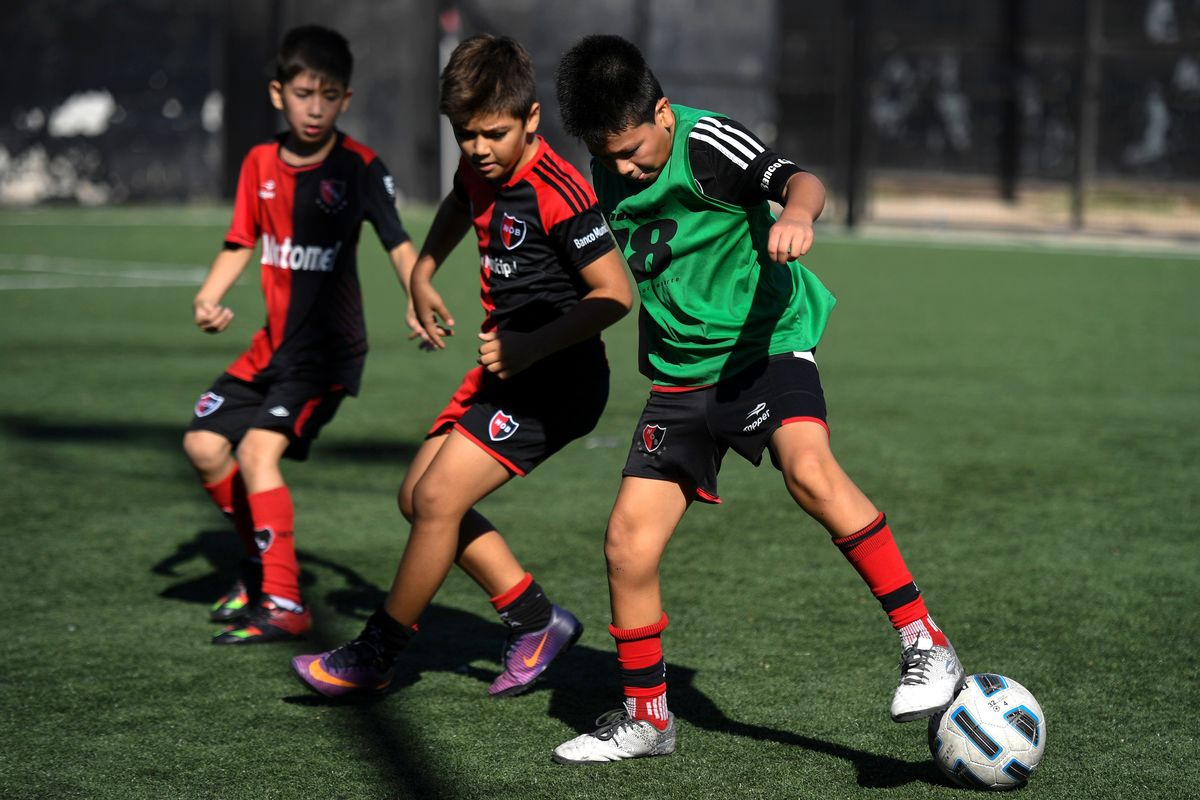 boys playing football (soccer) in Rosario, Argentina