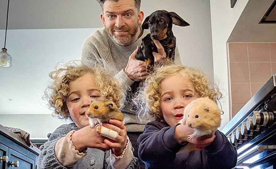 simon and the twins hold the family pets