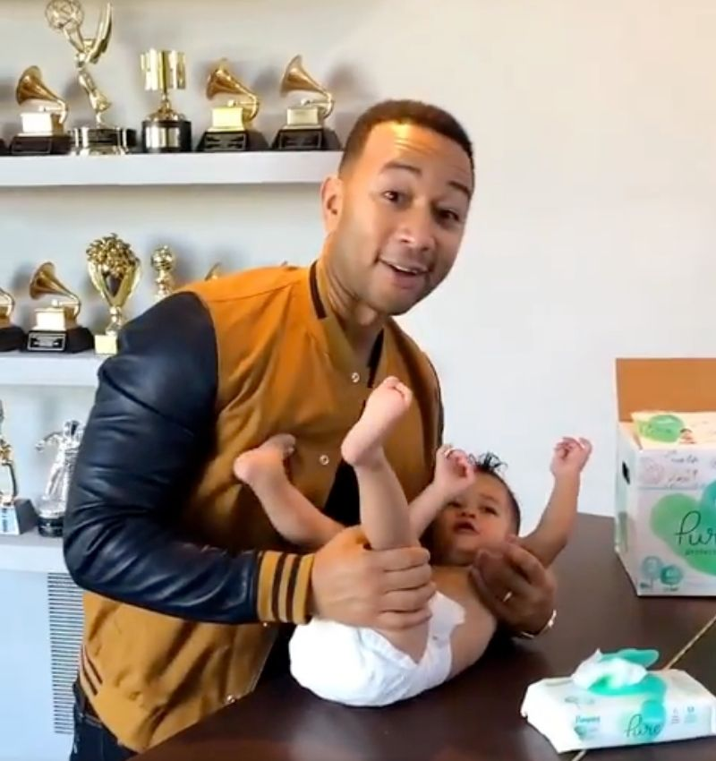 john legend changing diaper on top of piano