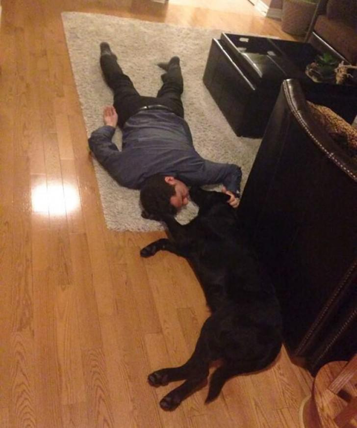 dad and dog on floor