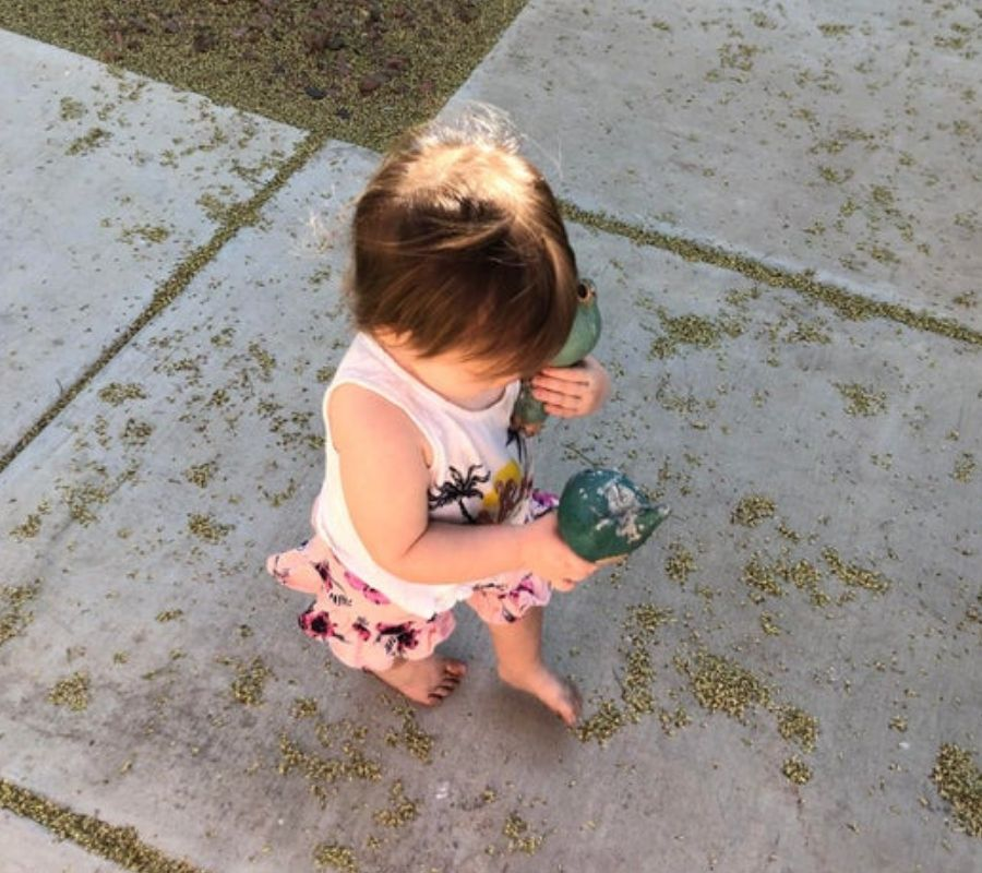 toddler bringing home lawn ornaments adorable