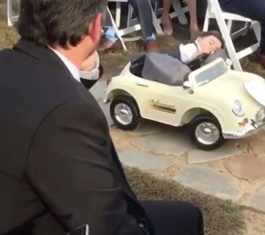 toddler asleep at the wheel tired in the middle of wedding ceremony