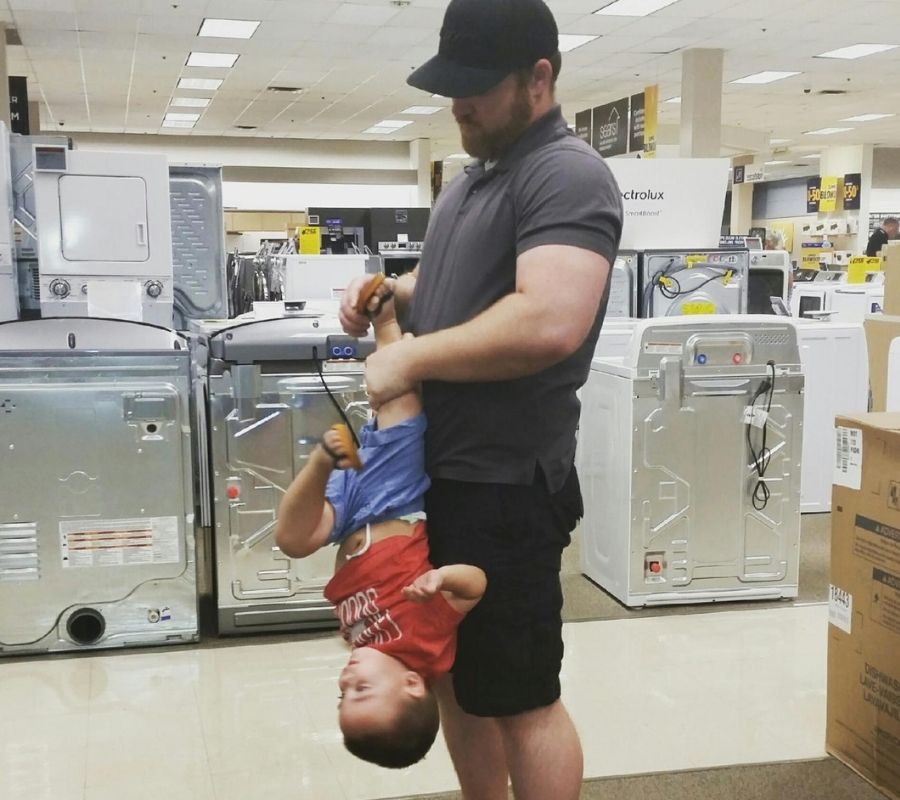 dad putting a shoe on a toddler upside down