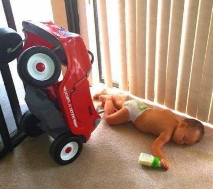 toddler drinking fell on floor looks like he was driving battery car too around house