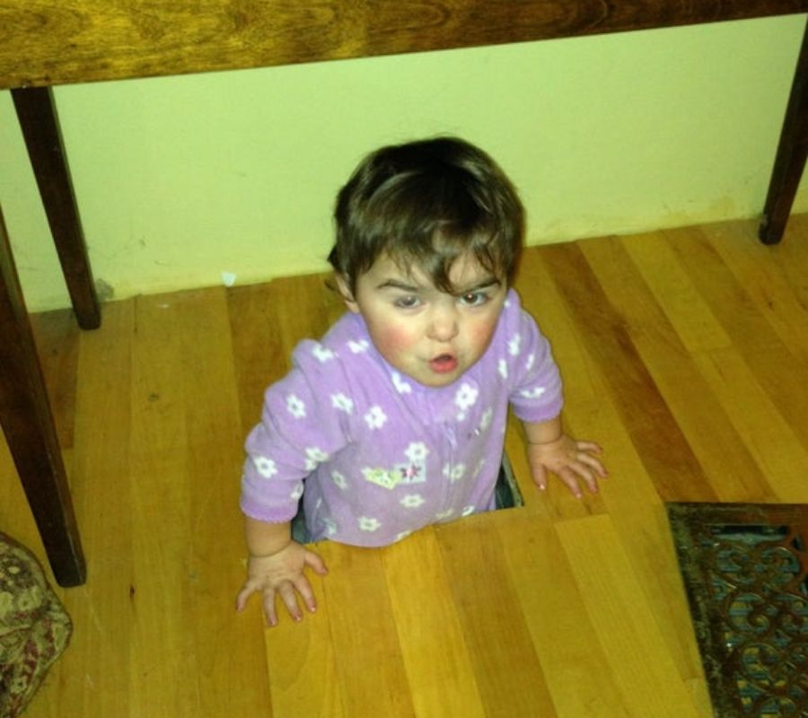 baby falling through the floor looks like it's in distress