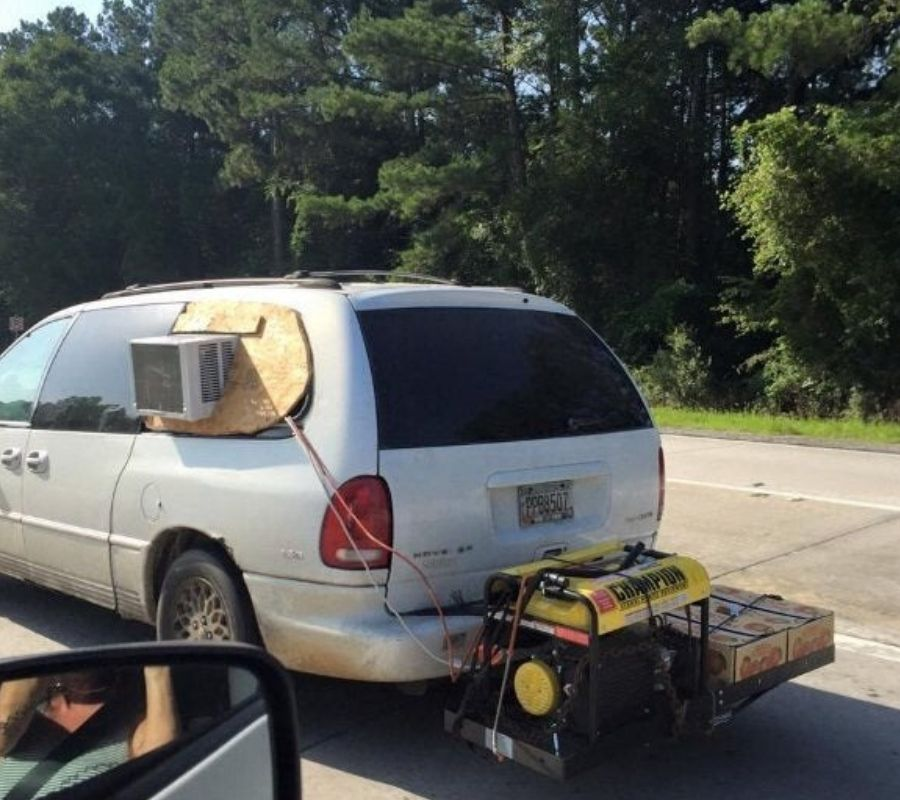 air conditioning unit on a car strapped to the side