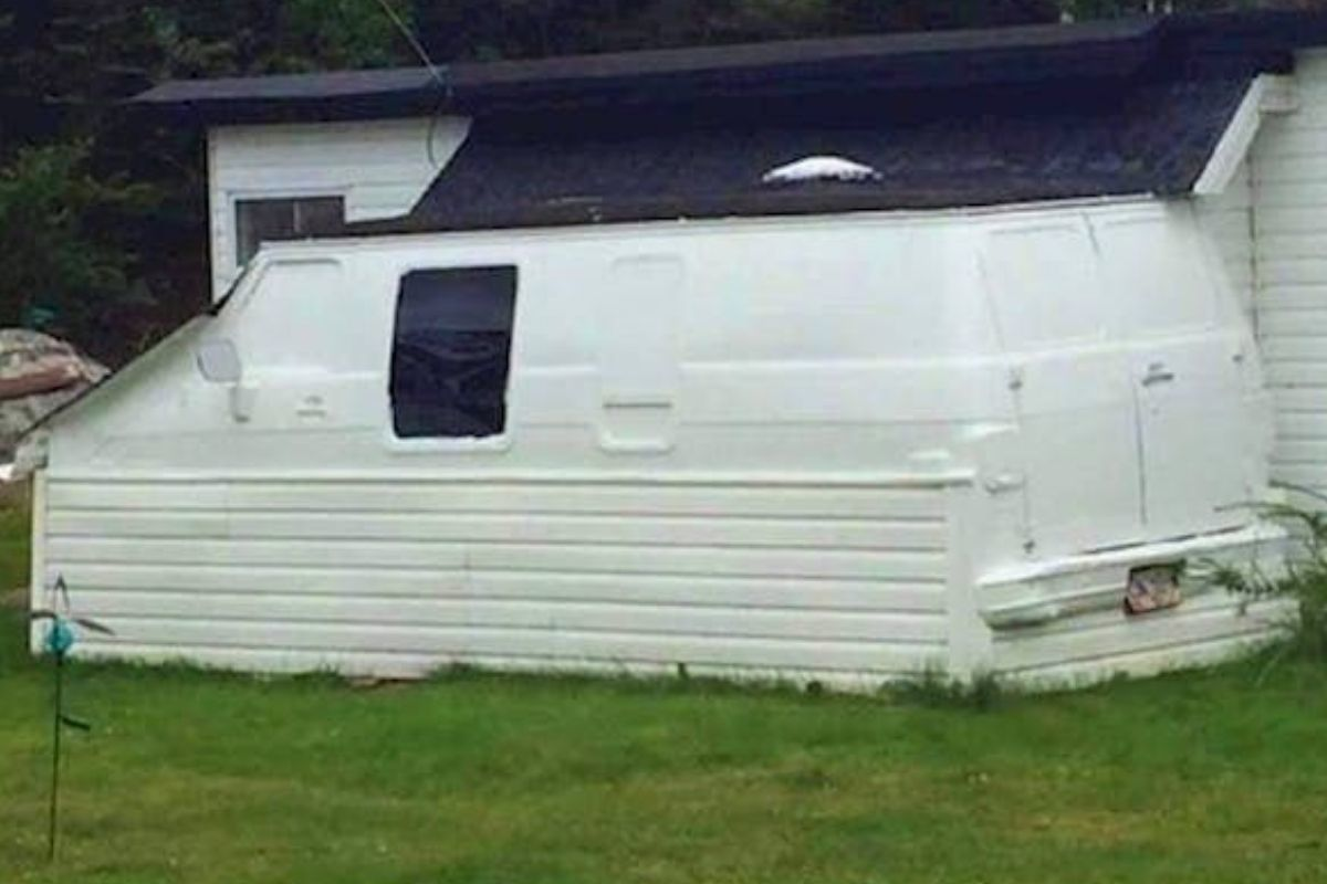van attached to mobile home siding