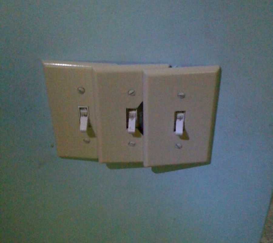 three lightswitches closely set up together and impractical