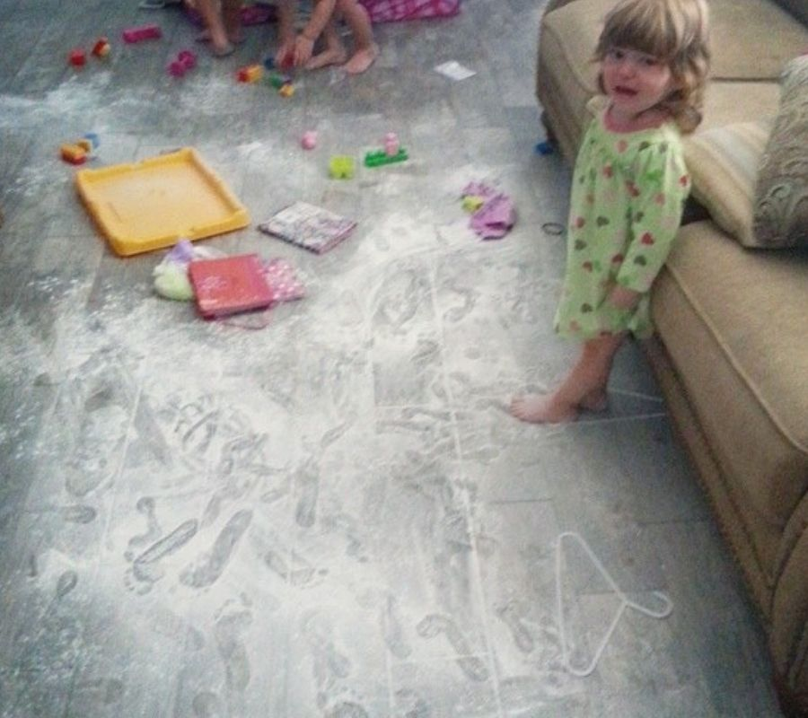 chalk mess kids child staring at camera looking distraught