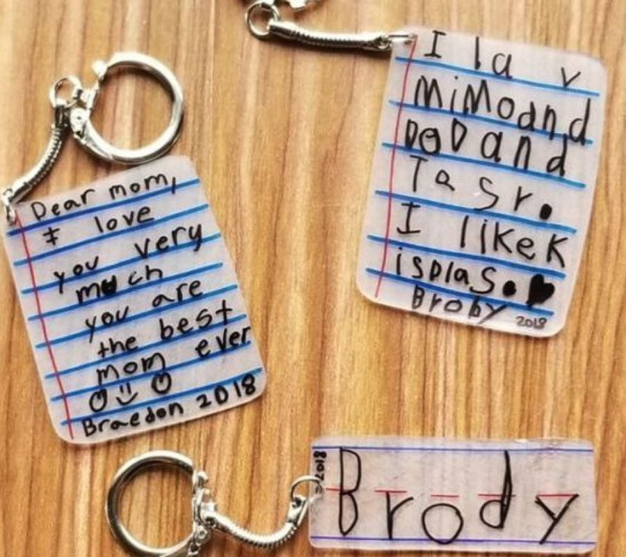 shrink film key chains paper with love messages on it