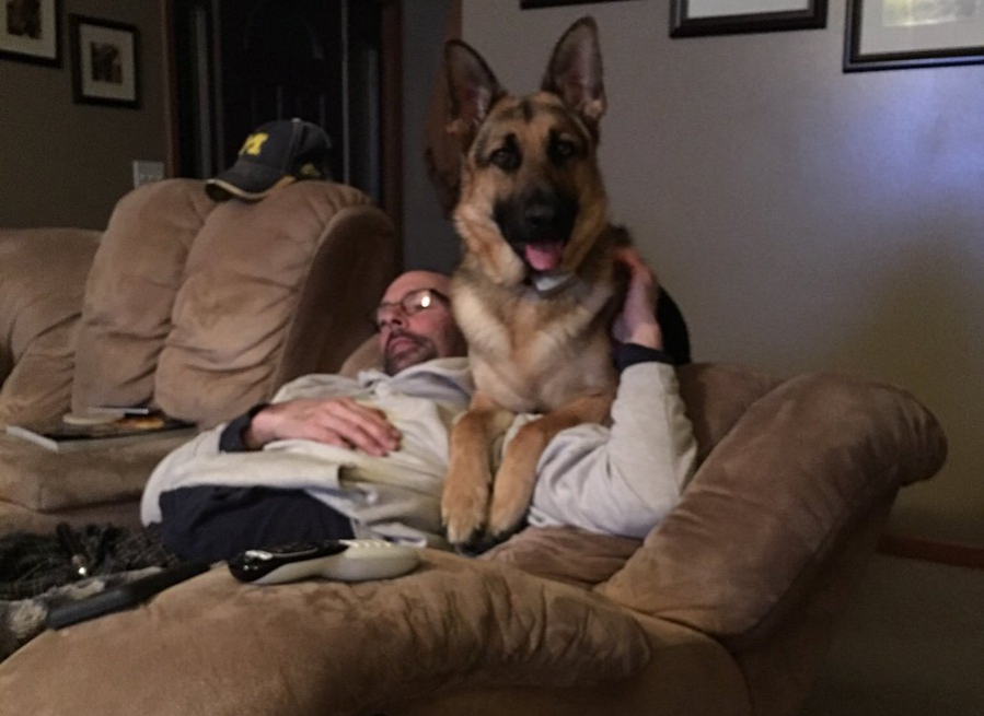 dog and dad in recliner