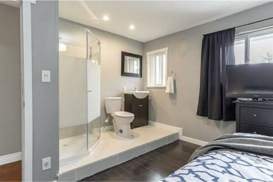 open concept room, bathroom with no door inside bedroom