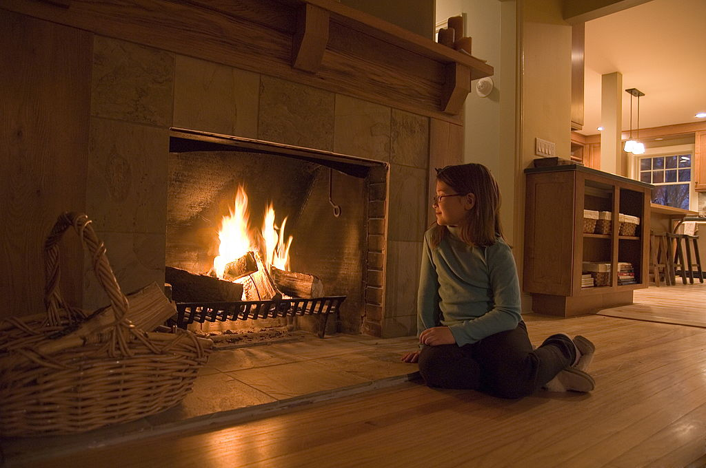 girl in front of fireplace
