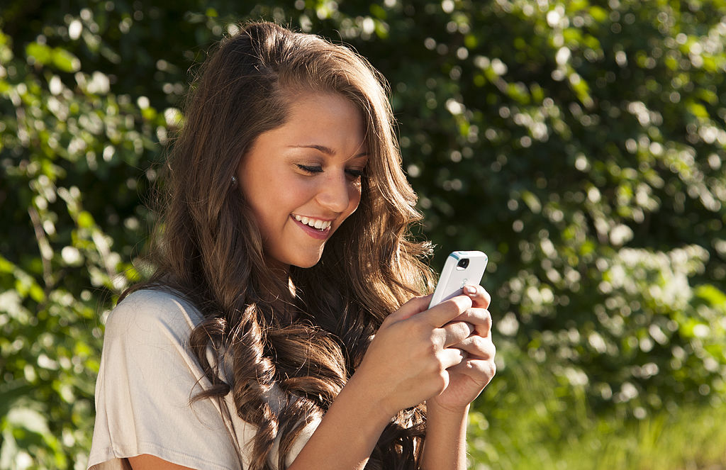 young woman texting her friends