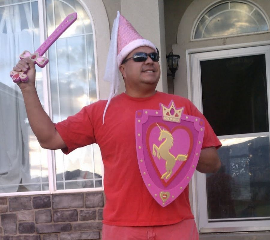 guy in princess costume and sword waving