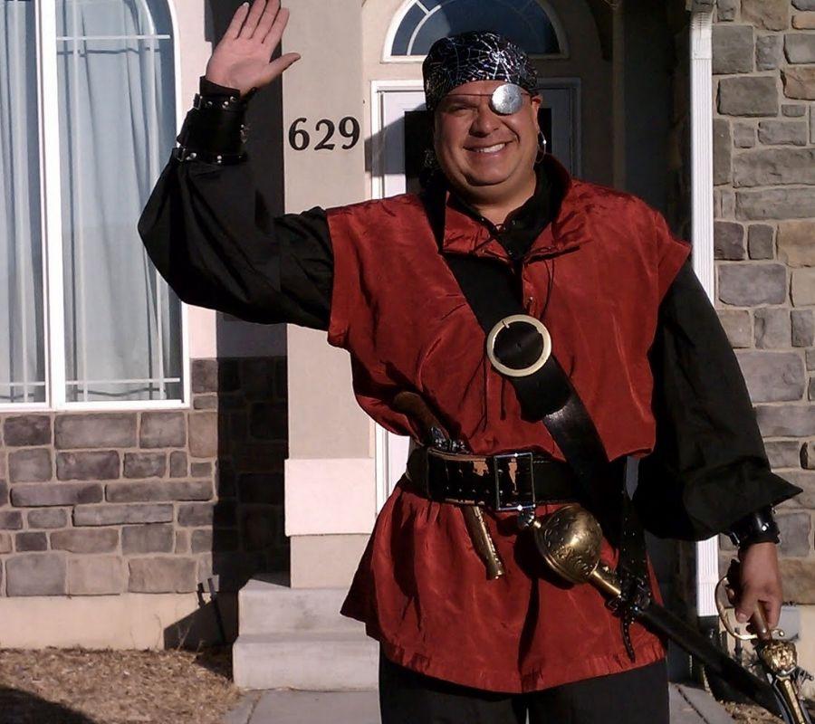 man waving goodbye as a pirate at busstop