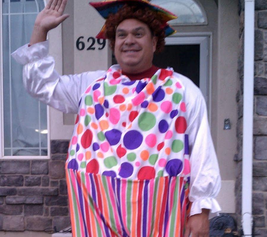 father in clown costume waving goodbye