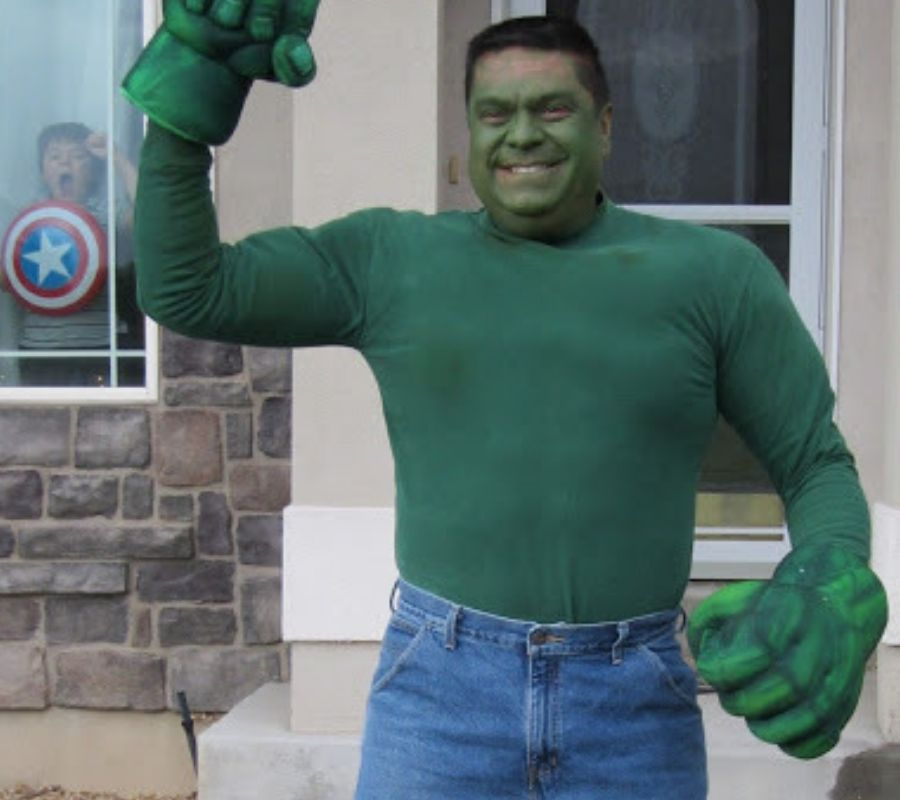 guy dressed as incredible hulk front yard