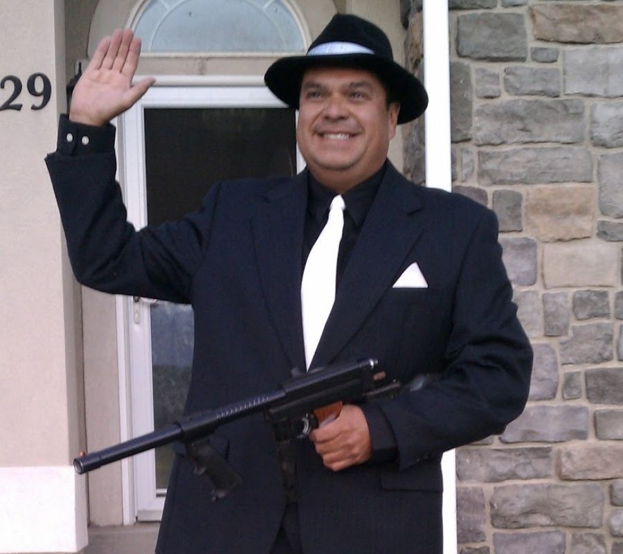 dad dressed as an old timey gangster
