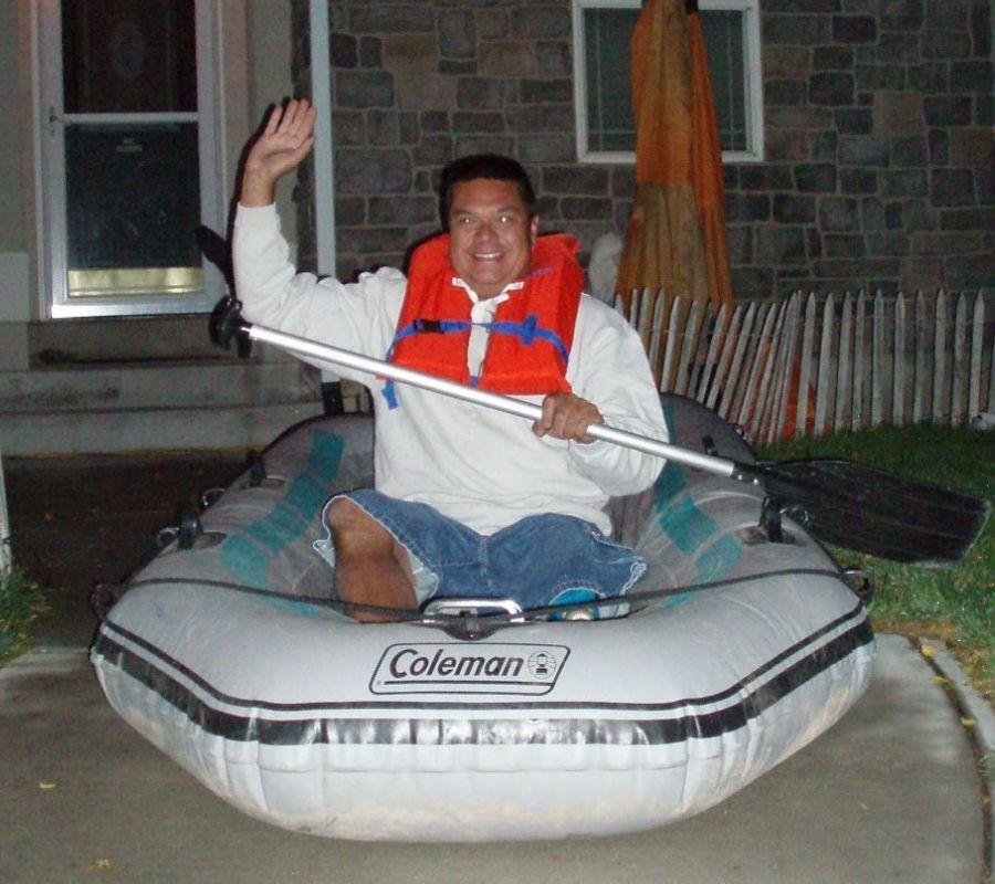 guy on raft waving