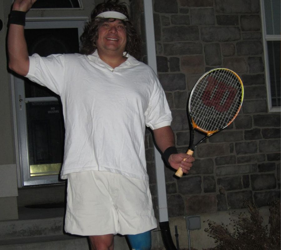 dad dressed like a tennis player