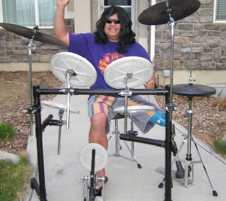 guy dressed as a rock drummer looking cool