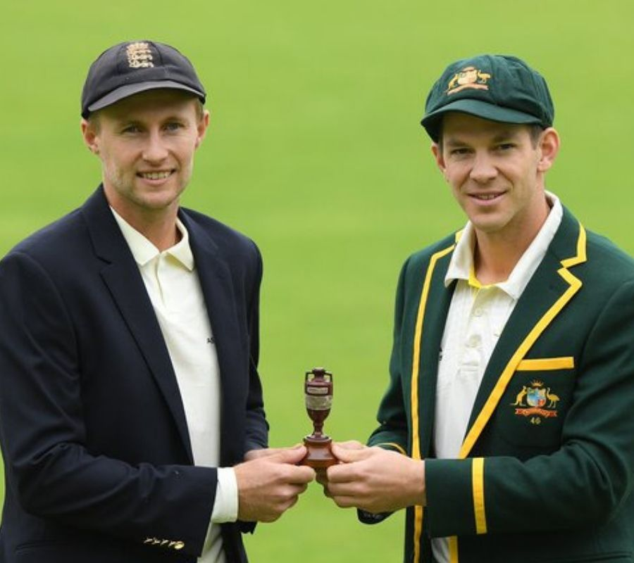 two guys holding world's smallest cricket trophy
