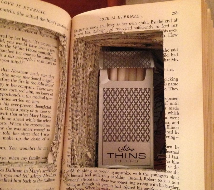 hollowed out book cigarettes inside