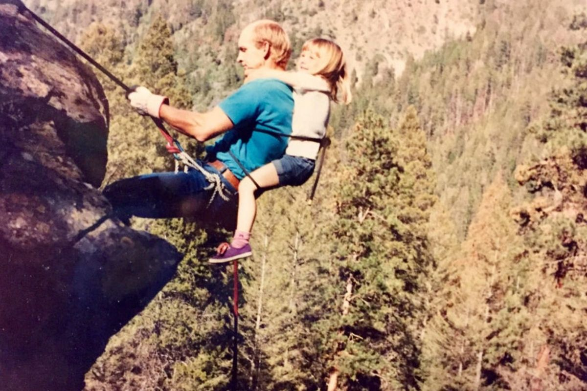 dad rapelling with daughter