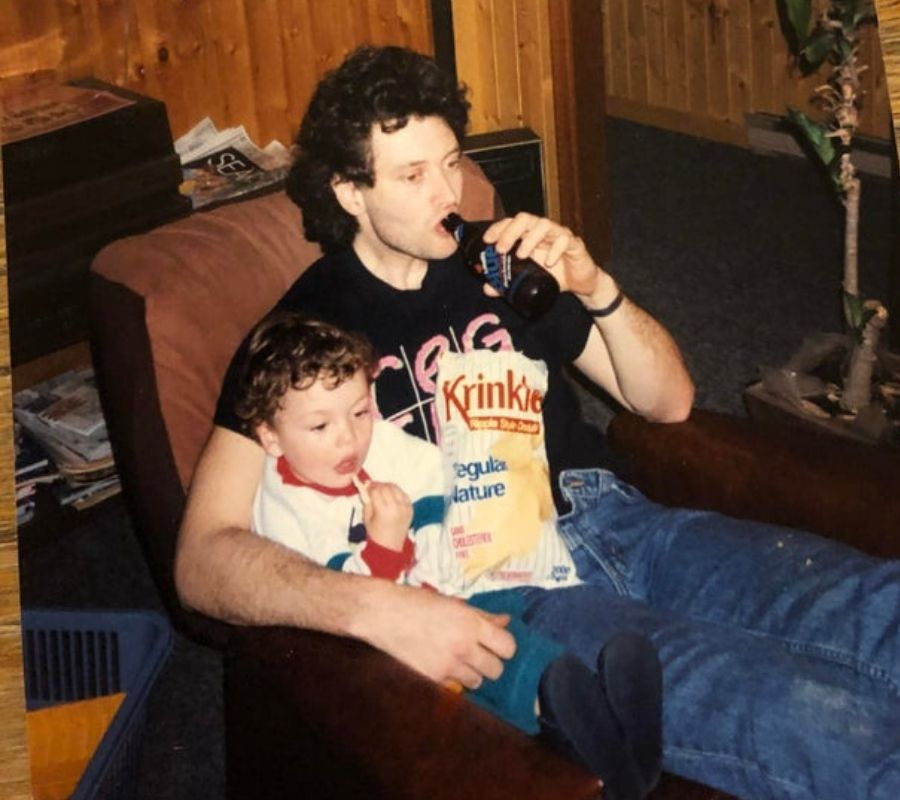 baby and dad with chips and beer