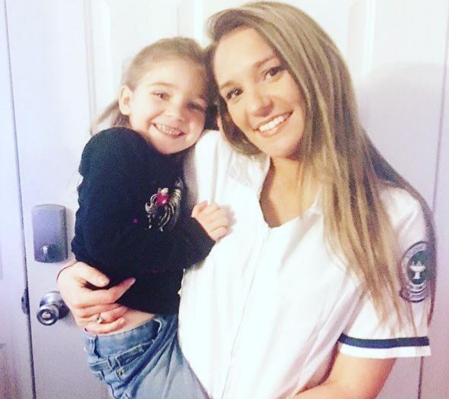 mom holding daughter