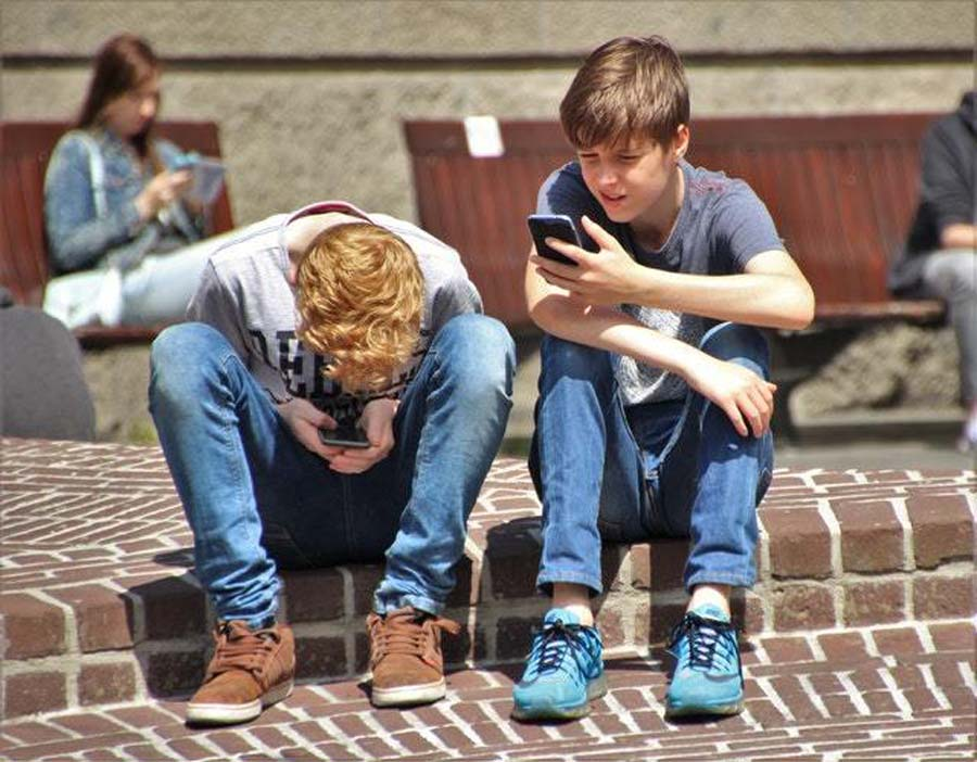 two boys on their cellphones