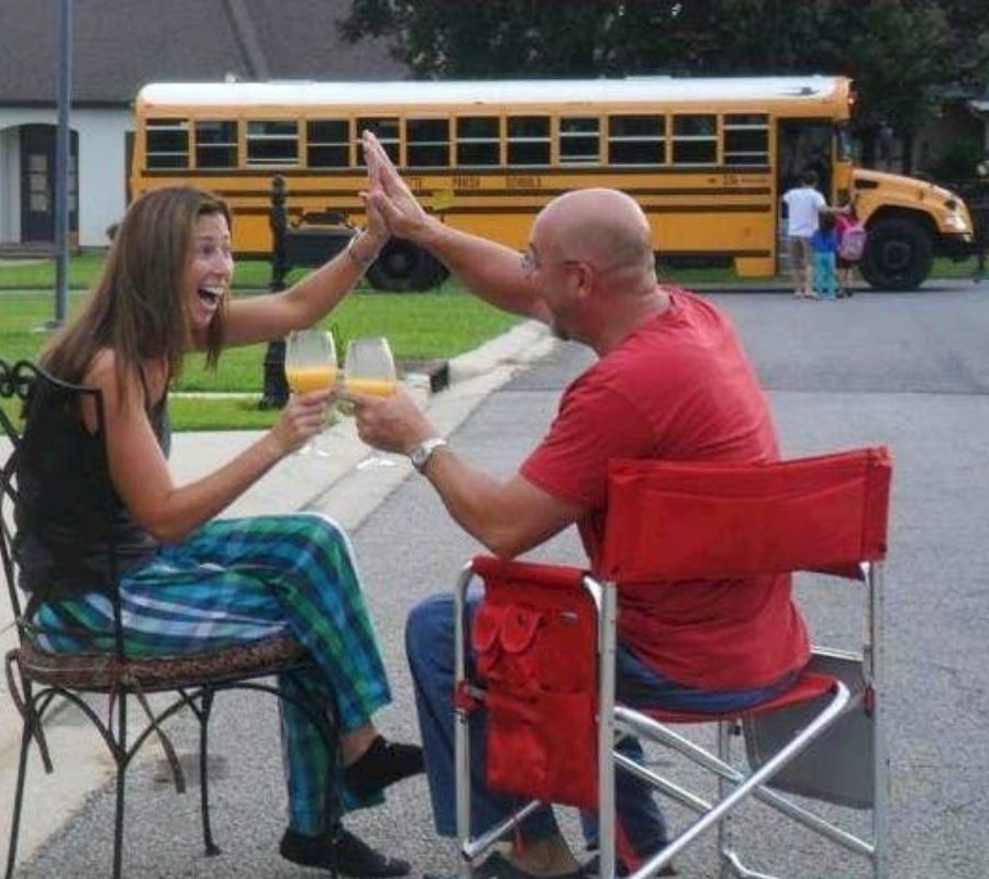 mom and dad celebrate their kids going back to school