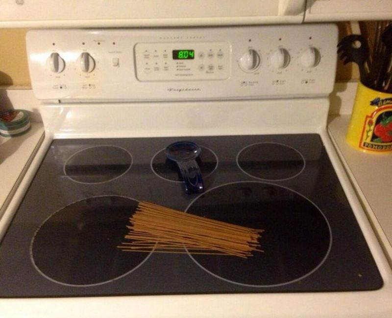 clever husband puts pasta on the stove
