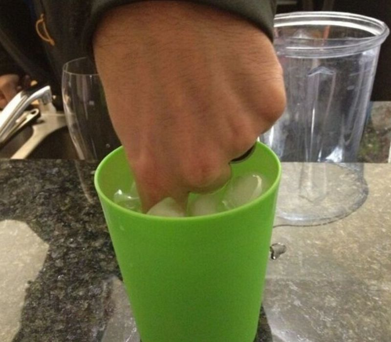 man stir cup finger