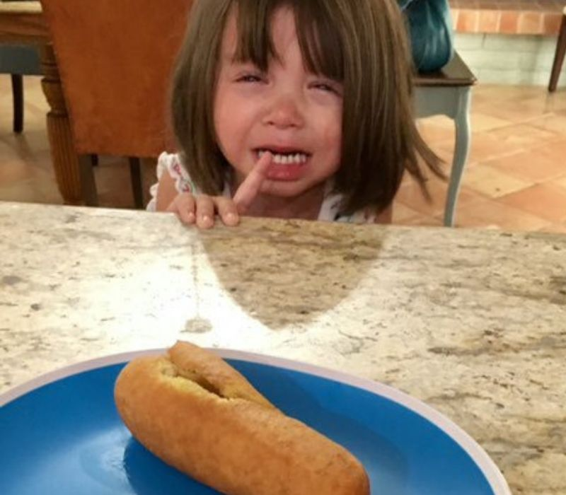 kid crying because corndog is ripped
