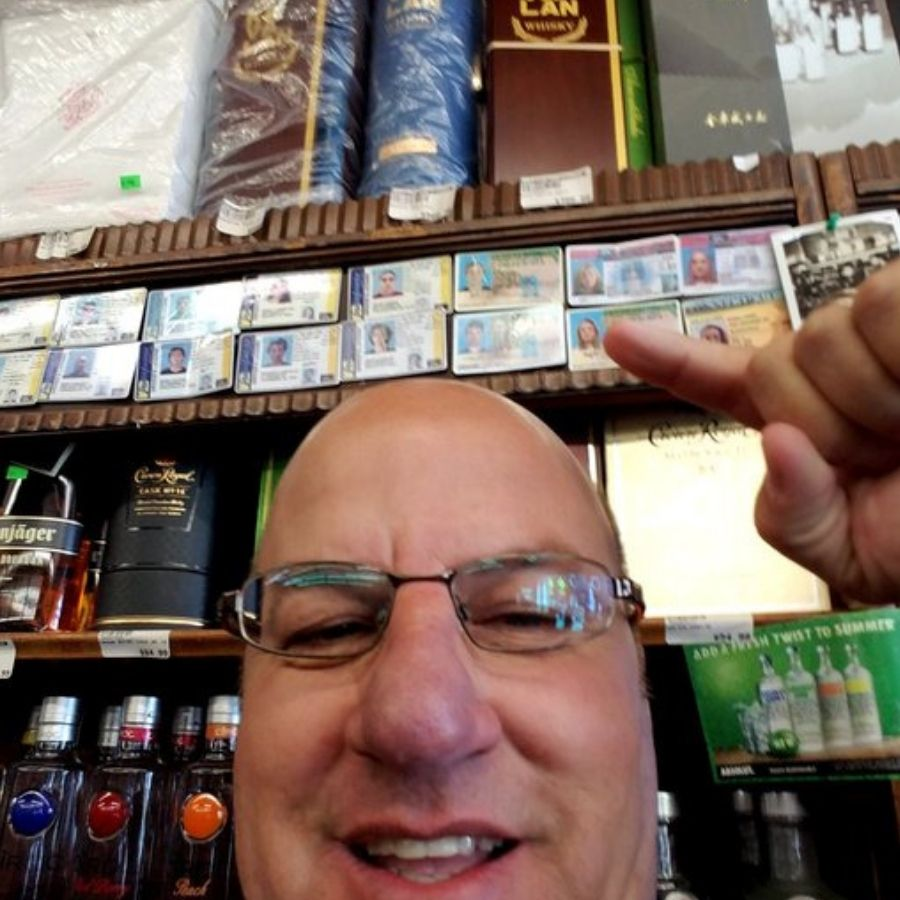dad at the liquor store finding son's fake id