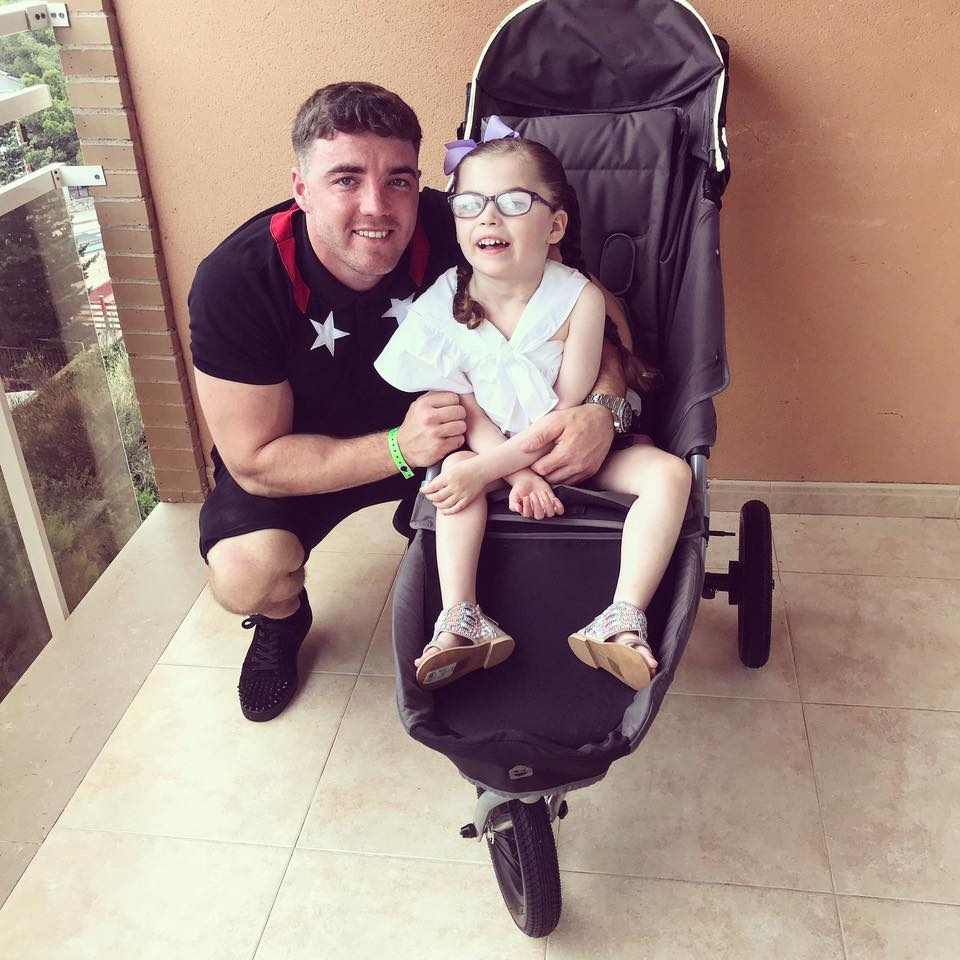 Photo of josh with Ava in a stroller